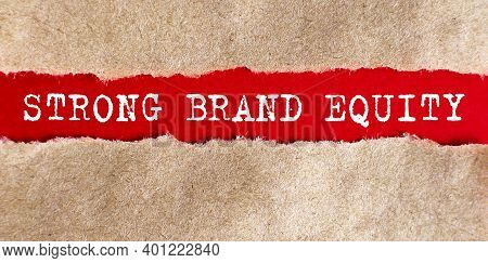Text Strong Brand Equity Appearing Behind Torn Paper