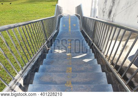 Concrete Stairs Of A Footbridge With Stainless Steel Handrails.
