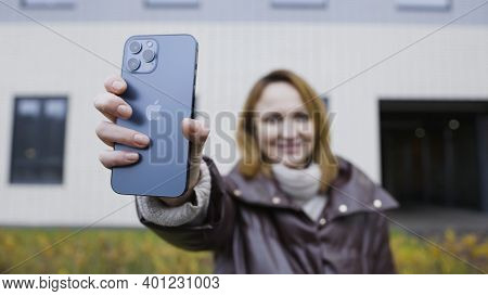 Moscow, Russia-november, 2020: Woman With New Iphone. Action. Woman Brags About New Iphone 12 Pro Ma