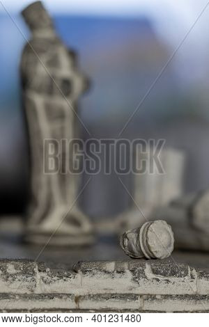 The Close Up Portrait Of A Broken Stone King Sculpture In A Game Of Chess Resembling The Defeat In T