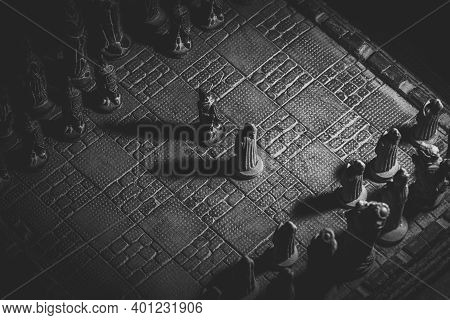 A Black And White Portrait Of Two Soldier Pieces Of A Game Of Chess Facing Each Other In The Beginni