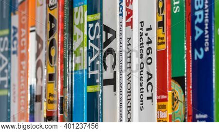 Detroit, Michigan - December 12, 2020 : Row of ACT and SAT books contain standardized practice tests for university admissions in USA.