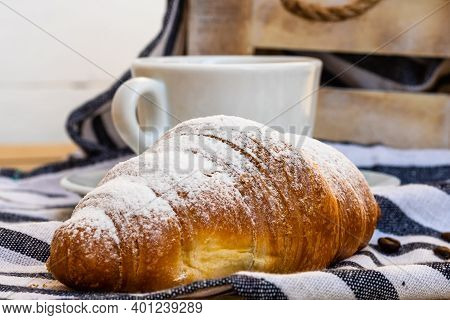 Puff Pastry, Coffee Cup And Buttered French Croissant On Wooden Crate. Food And Breakfast Concept. D