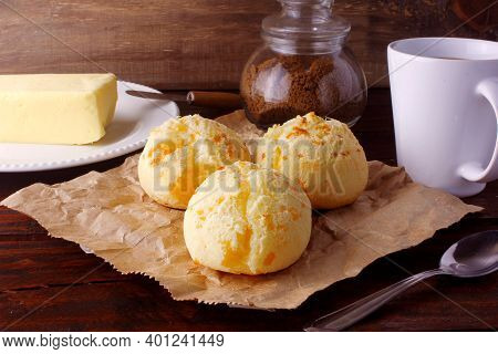 Homemade Cheese Bread, Traditional Brazilian Snack, On The Breakfast Table In A Rustic Farm Kitchen.