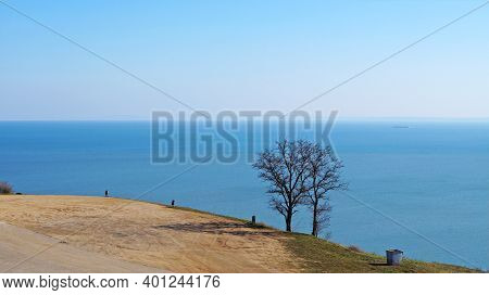 Panoramic View Of The Black Sea From The Mountain In The City Of Kerch Under The Blue Sky On A Sunny