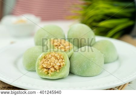 Chinese Dessert Or Sweet Mochi With Ground Peanut And Sugar Filling