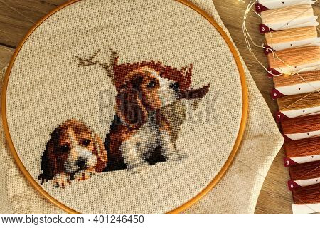 Cross Stitch Two Puppies Next To The Thread