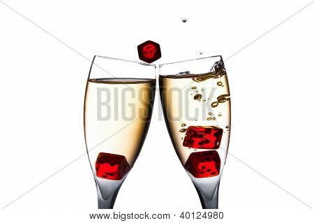 Red Dice In Movement In Two Flutes With Gold Bubbles