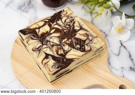 Steamed Marble Chocolate Cheesecake On Wooden Chopping Board