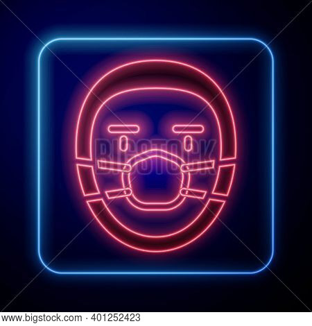 Glowing Neon Doctor Pathologist Icon Isolated On Blue Background. Vector