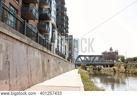 View Down Path Of Cherry Creek Trail Along Platte River.  Surrounded By Apartments And Condominiums
