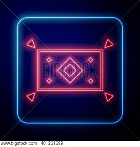 Glowing Neon Magic Carpet Icon Isolated On Blue Background. Vector