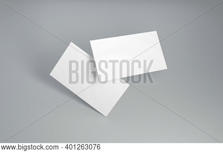 Floating Business Card Mockup. Closeup On Two Empty Business Cards Floating In The Air In Front Of T