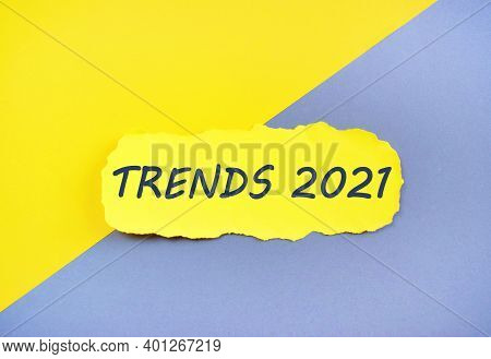 Handwriting Text Writing Trends 2021 On Torn, Colored Paper. Concept For 2021 Trends .yellow And Gre