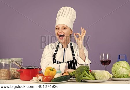 Just Perfect. Happy Smiling Chef Preparing Meal With Various Vegetables. Ready To Cook New Dish. Fre