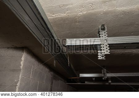 The Metal Frame On The Ceiling For Attaching Sheets Of Drywall. Installation Of A Suspended Ceiling