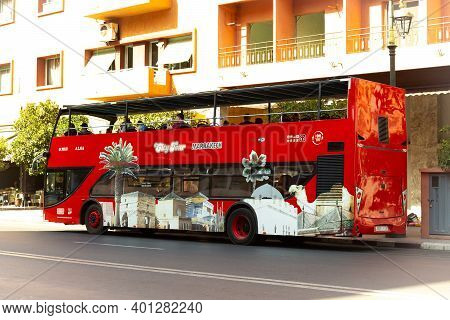 Marrakech, Morocco - 12 October, 2019: Red Excursion Bus On The City Street