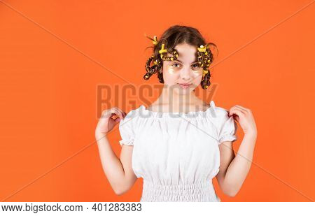 Adorable Child Hairdo. Daughter With Curlers On Her Head Laughing. Hairdresser Salon. Female Beauty