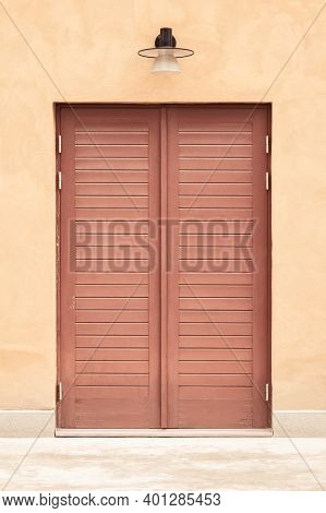 Pastel Building With A Red Wooden Door. Entrance To A Modern Building.