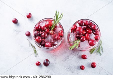 Cranberry Rosemary Gin In Glass With Fresh Cranberries