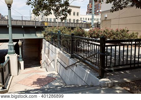 Stairs Descending Under Overpass.  In The Riverfront Park Neighborhood Of Downtown Denver, Colorado.