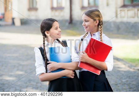 Primary And Secondary Schooling. Happy Children Hold Books Outdoors. Formal Schooling. School Educat