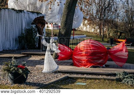 Christmas Decorations, Angel, Garlands And Ribbons At Baroque Castle Park In Winter Sunny Day, Histo