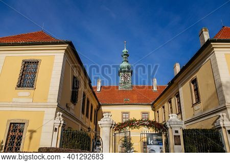 Baroque Chateau With Clock Tower, Castle And Town Gallery With Christmas Decorations In Winter Sunny