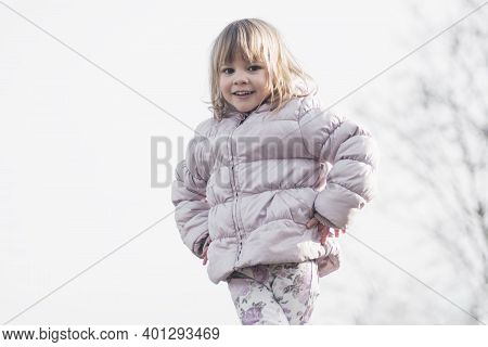 Cute Little Girl In Warm Jacket At Winter On White Background.