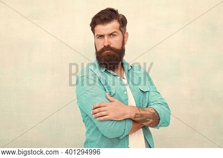 Denim Fashion Trends. Barbershop Fashion. Charismatic Barber With Beard And Mustache. Personality An