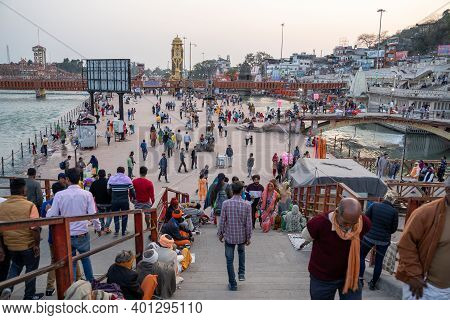 Haridwar, India - Feburary 22, 2020: People Gather Near The Ghats Prior To The Ganga Aarti Evening C