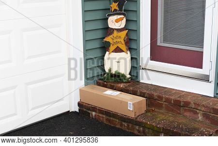 A Package Is Left By The Side Door O A Residential House In December Left Vulnerable To Porch Pirate