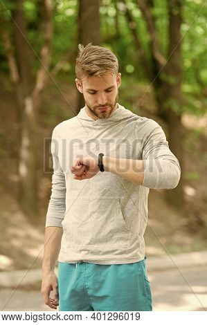 Watch Ideal For Active Lifestyle. Athletic Man Check Pulse By Watch. Handsome Athlete Use Smart Watc