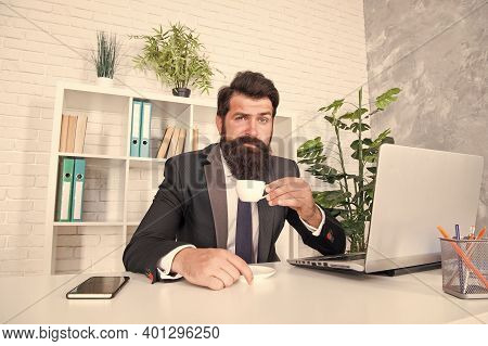 Who Doesnt Love Drinking Hot Cup In Morning. Engineer Hold Tea Cup At Work Desk. Bearded Man Enjoy D