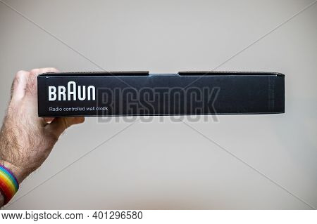 Paris, France - Dec 8, 2020: Pov Personal Perspective Male Hand Holding Package Of New Braun Bc17f-d