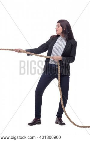 Full length portrait of businesswoman pulling an rope in tug of war concept