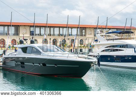 Yachts And Speed Boats At Harbor. Power Boats Moored In Marina. Sea Coast Pier. High Class Lifestyle