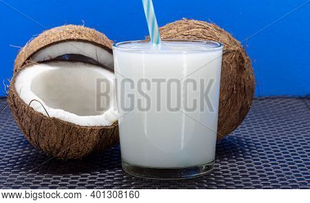 Dried Coconuts. Fresh Fruits. Pink Colored Wood Background. Refreshing Drink. Bottles With Coconut W