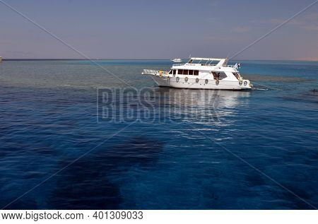 Sail boat ship with tourists in Ras Mohamed National Park in the Red Sea, Sharm El Sheikh, Egypt on November 6, 2020