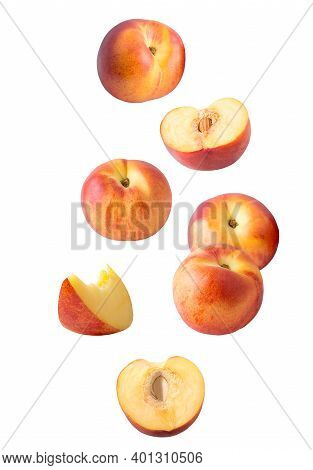 Falling Sliced Peach Fruit Isolated On White