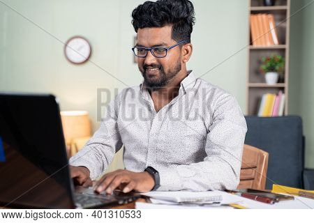 Happy Young Man Busy Working On Laptop At Home - Concept Of Professional It Employee During Work Fro