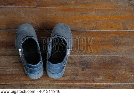 Student Old Black Standard Shoes On The Wooden Floor Of School Ancient Building On Semester Close