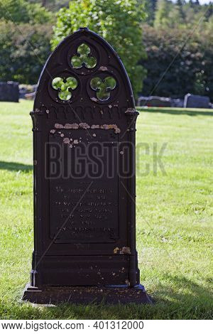 Umea, Norrland Sweden - June 28, 2020: Old Tombstone With A Poem As Inscription