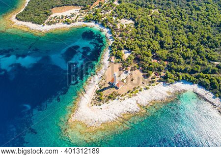 Drone Aerial View Of Lighthouse Tower Of Veli Rat On The Island Of Dugi Otok, Croatia