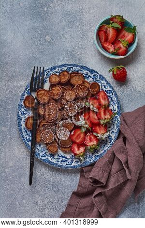 Mini Chocolate Pancake Cereal With Strawberries For Breakfast On Gray Concrete Table. Trendy Home Br