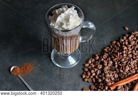 Cappuccino With Cinnamon. A Glass Of Fresh Cappuccino On The Table.