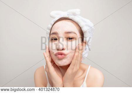 A Woman Put A Mask On Her Face After A Shower