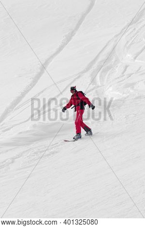 Snowboarder In Red Downhill On Snowy Off-piste Slope After Snowfall At Gray Winter Day. Selective Co