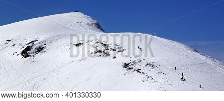 Snowboarders And Skiers On Snowy Off Piste Slope At Sun Day. Caucasus Mountains At Winter, Georgia,