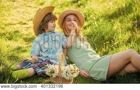 Family Time. Mother And Kid Relax In Park. Picnic On Green Grass. Spring Bloom In Basket. Mother And